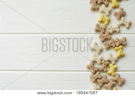 Small Dog Cookies On A White Wood Background. Dog Food. Copy Space