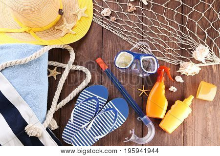 Beach accessories on the brown wooden table