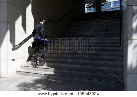 Businessman going up the stairs, he is hurrying to work