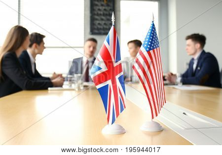 Diversity people talk the international conference partnership. American flag and British flag