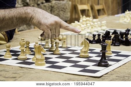 Playing chess in a game on the street wit game detail