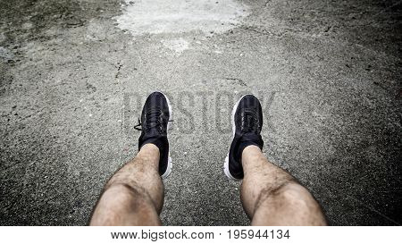 Legs of a man resting in the city detail of a moment of relax and rest