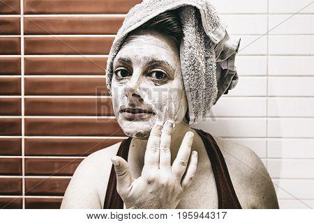 Young Woman Putting Facial Creams