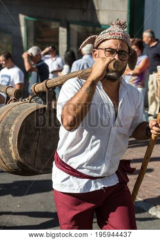ESTREITO DE CAMARA DE LOBOS PORTUGAL - SEPTEMBER 10 2016: Man wearing in traditional costume at Madeira Wine Festival in Estreito de Camara de Lobos Madeira Portugal.