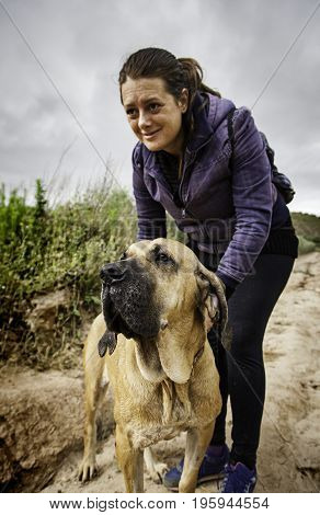 Young woman with hound dog in nature detail of love and friendship animal respect