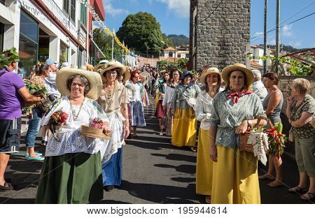 ESTREITO DE CAMARA DE LOBOS PORTUGAL - SEPTEMBER 10 2016: Women wearing in traditional costumes at Madeira Wine Festival in Estreito de Camara de Lobos Madeira Portugal.