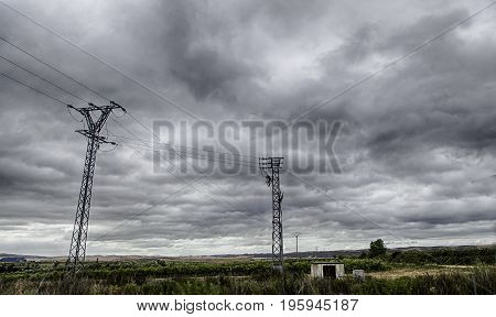 Electrical towers in a storm electricity transport detail