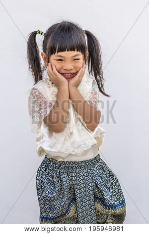Little girl at 3.9 years old with Thai traditionnal-modern custume