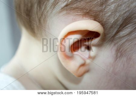 Earache. Atit Child. Ear Close-up