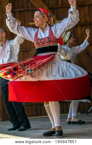 TIMISOARA ROMANIA - JULY 9 2017: Dancer girl from Portugal in traditional costume perform at the international folk festival