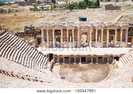 Roman Hierapolis with adjacent remains of buildings Pamukkale Turkey.Ruins of theater