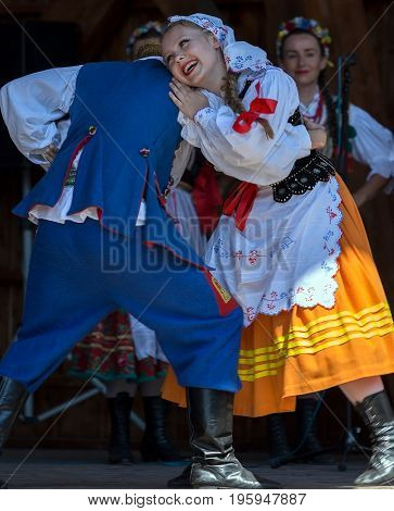 TIMISOARA ROMANIA - JULY 9 2017: Dancers from Poland in traditional costume perform at the international folk festival