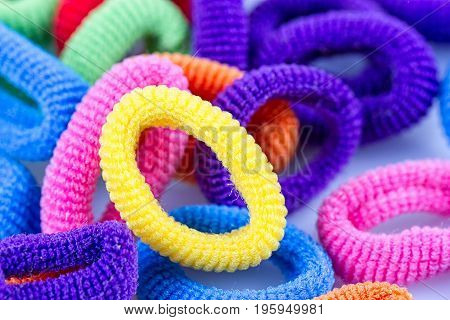 the hair multicolored rubber bands grouped close-up