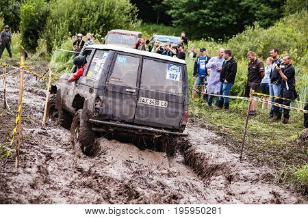 LUBOTIN UKRAINE - JULY 23 2016: RFC Ukraine Wild Boar Challenge 2016. Toyota LandCruiser Prado 70 driving through deep mud.