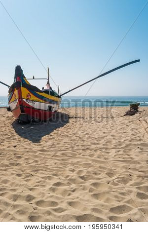 ESPINHO PORTUGAL - JULY 16 2017: Arte Xavega typical portuguese old fishing boat on the beach in Paramos Portugal