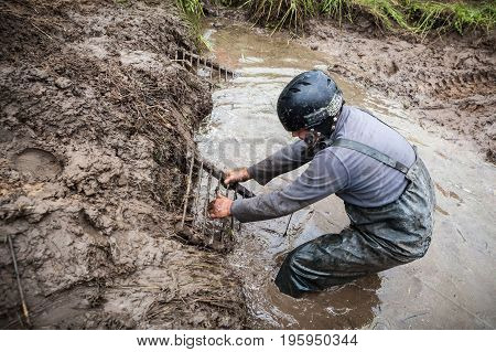 LUBOTIN UKRAINE - JULY 23 2016: RFC Ukraine Wild Boar Challenge 2016. Pilot tries to get recovery sand tracks from deep mud.
