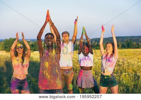 Multicultural Happy Friends With Outstretched Arms And Colorful Powder On Clothing At Holi Festival