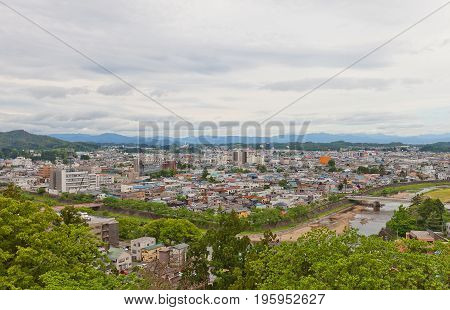 YOKOTE JAPAN - MAY 26 2017: View of Yokote City from Main Keep of Yokote Castle. Yokote is located in southeast corner of Akita Prefecture by the Ou Mountains and Iwate Prefecture to the east