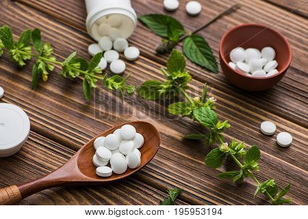 Natural Organic Pills With Herbal Plant
