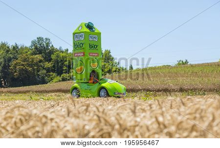Saint-Quentin-Fallavier France - July 16 2016: The Vehicle of Pressade during the passing of Publicity Caravan in a wheat plain in the stage 14 of Tour de France 2016. Pressade is a French producer of fruit juices.