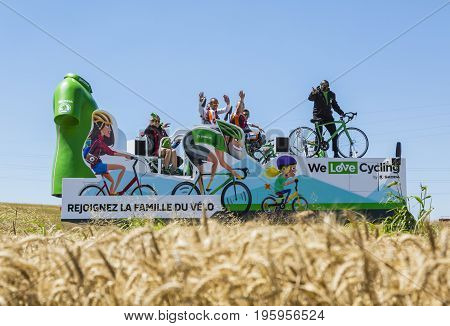 Saint-Quentin-Fallavier France - July 16 2016: The truck of Skoda during the passing of Publicity Caravan in a wheat plain in the stage 14 of Tour de France 2016. Skoda provides the official car of the competition and it sponsors The Green Jersey.