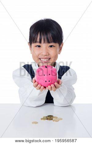 Asian Chinese Little Girl Holding Piggy Bank