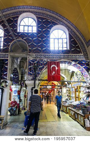 ISTANBUL TURKEY - MAY 21 2016: Grand Bazaar in Istanbul with unidentified people. It is one of the largest and oldest covered markets in the world with 61 covered streets and over 3000 shops