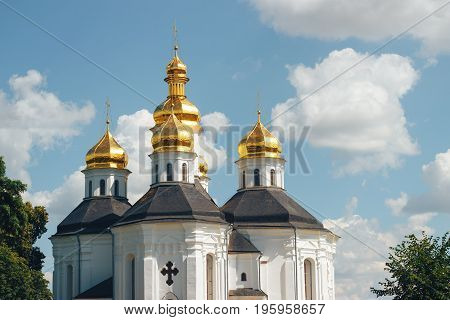 Golden domes of the orthodox church against the blue sky