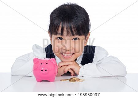 Asian Chinese Little Girl Smiling With Piggy Bank