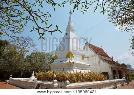 Exterior of the Phra That Si Song Rak temple with the inclined stupa in Loei, Thailand.