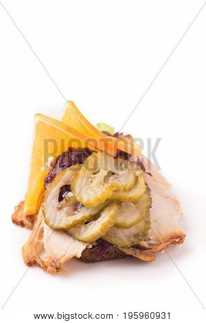 Danish specialties and national dishes high-quality open sandwich. Roasted Pork belly and Pickled red cabbage and orange isolated on white background