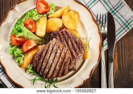 Succulent Portions Of Grilled Fillet Mignon Served With Baked Po
