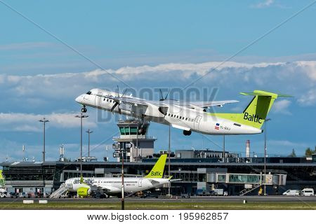 Riga, LV - JULY 16, 2017: AirBaltic Airplane Leaving Riga International Airport