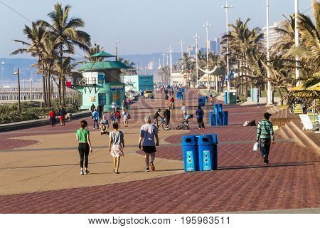 Pedestrians And Cyclists On Paved Beachfront Promenade