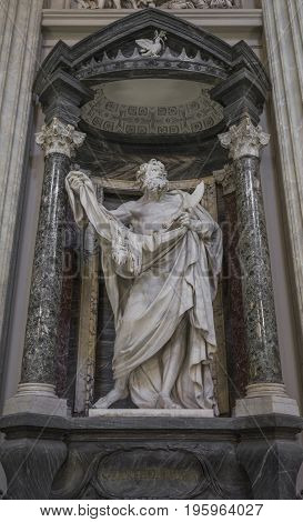 Statue of Saint Bartholomew the martyred apostle holding his flayed skin and flaying knife in Basilica of St. John Lateran in Rome. Rome Italy June 2017