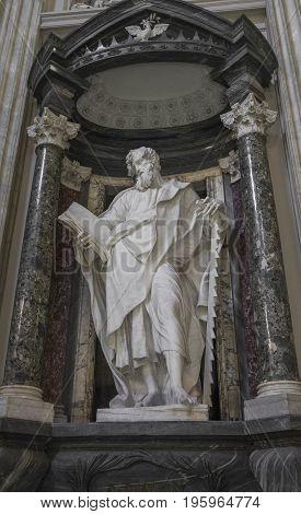 A marble statue disciple of Jesus the Apostle of St. Simon in Basilica di San Giovanni in Laterano (St. John Lateran basilica) in Rome. Rome Italy June 2017