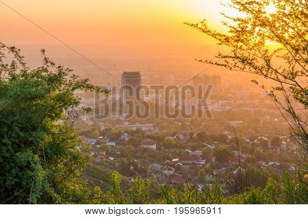 Almaty city in the fog in sunset with smog and dust in the air Kazakhstan.