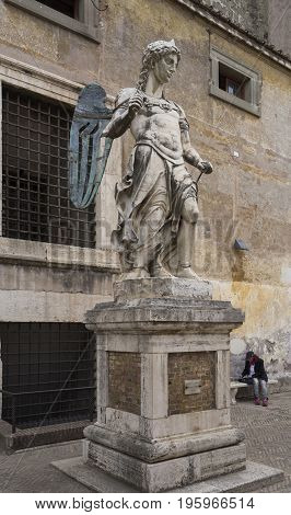 Old statue of Michael the Archangel in yard of Castle Saint Angelo. Rome. Italy. June 2017
