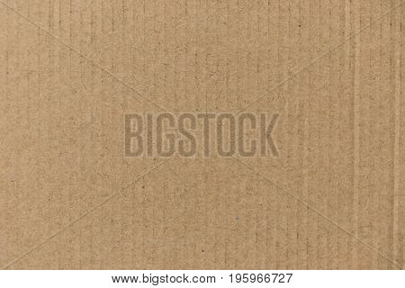 Closed up of brown color corrugated paper board background used as wallpaper decoration design element