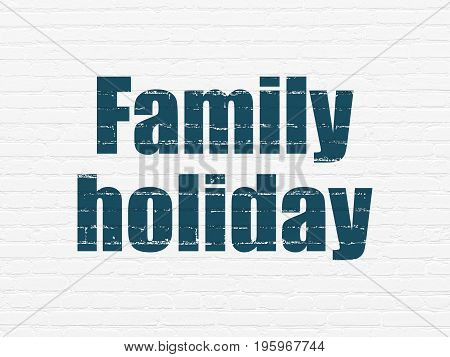 Vacation concept: Painted blue text Family Holiday on White Brick wall background