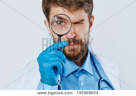 Young guy with a beard on a white isolated background, medicine, science, doctor, scientist.