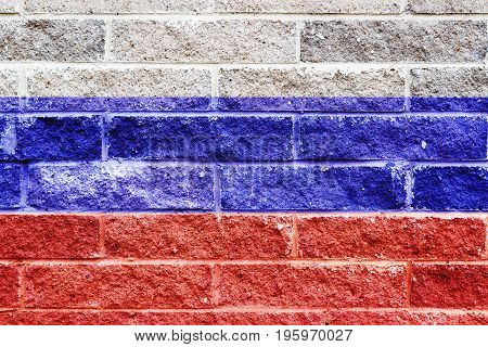 Russian Flag Painted On A Gray Stone Bricks Wall