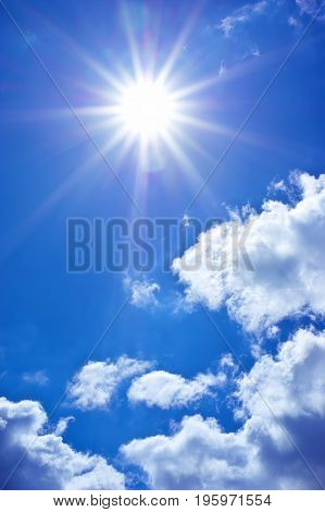 Deep blue sky at sunny day. Sun in deep blue sky with clouds