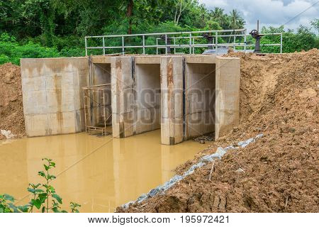Water gate was located in irrigational canal at rural area due to water reservation for agricultural purposes.