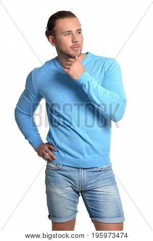 Handsome young man in blue sweater isolated on white background