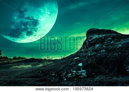 Landscape Of The Rock With Night Sky And Big Moon Above Wilderness Area In Forest.