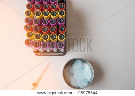 Top view colorful sample blood tube and syringe, cotton from patient  in Laboratory . Medical equipment.