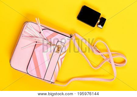 Purse In Light Pink Color And Perfume. Fashion And Glamour
