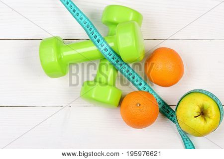 Apple, Orange With Measuring Tape, Weight Dumbbells For Diet Concept