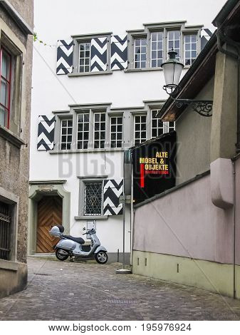 Zurich, Switzerland - August 9, 2007: Downtown City With Motorcycle And Sign Of Alte Mobel And Objek